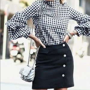 Ruffle blouse with black and white squares
